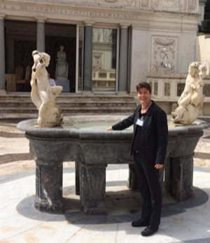Jenny Reardon standing in front of a fountain at the Vatican.