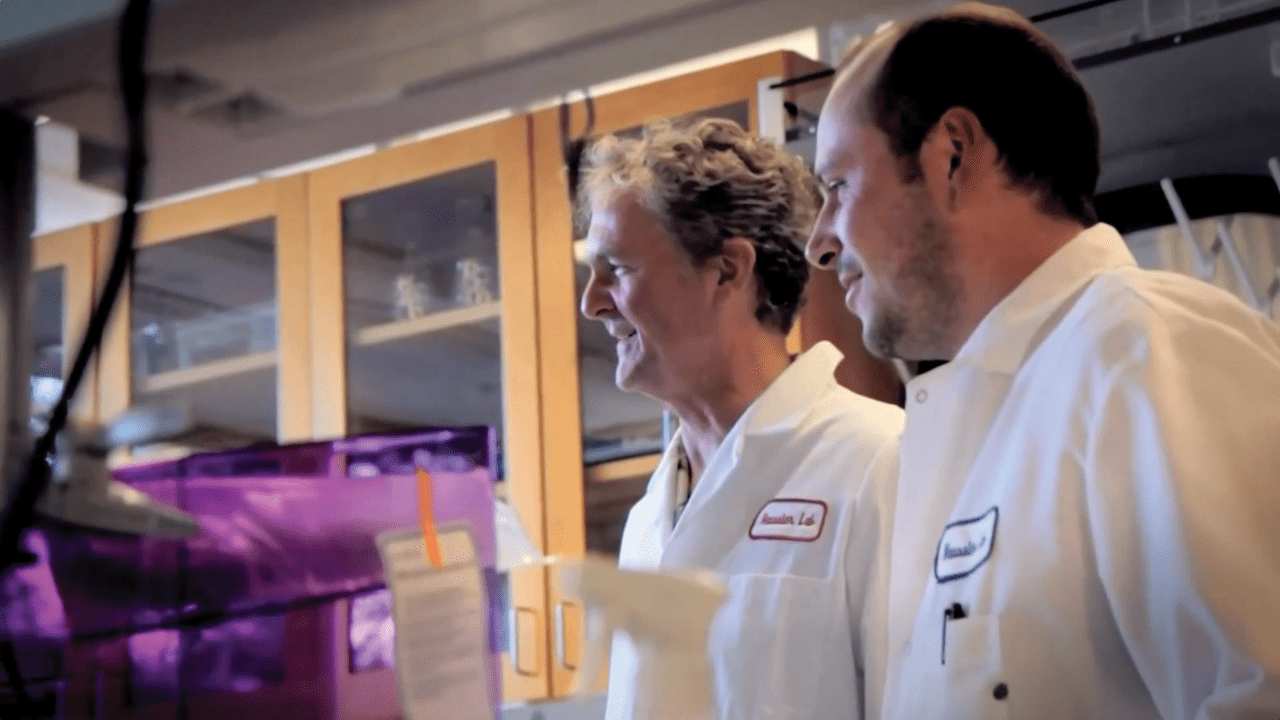 Haussler and colleague in lab coat