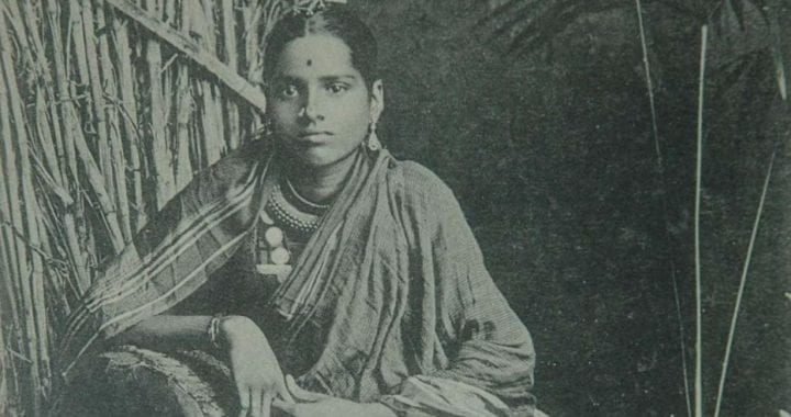 Black and white photo from theGomantak Maratha Samaj Archives, Mumbai of a seated person wearing Indian clothing