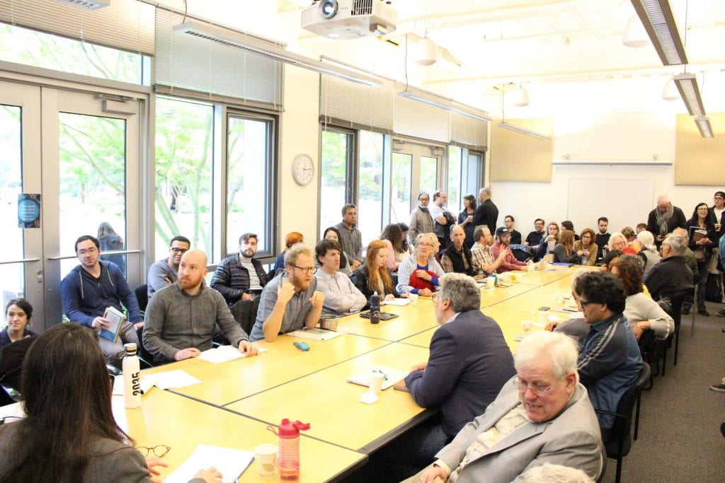 Photo of the Center for Cultural Studies colloquium audience around a long table