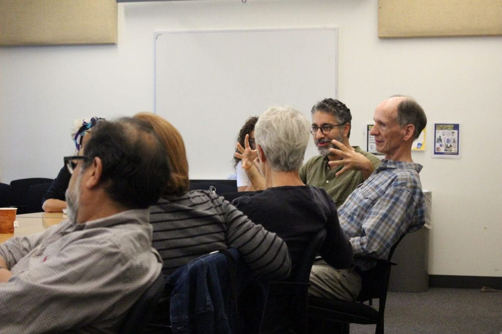 Colloquium audience member Raed Rafei asking a question during Elizabeth Marcus' colloquium