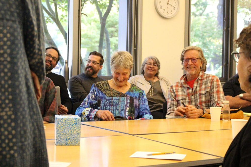 Colloquium audience members laughing