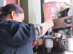 barista making a cappuccino