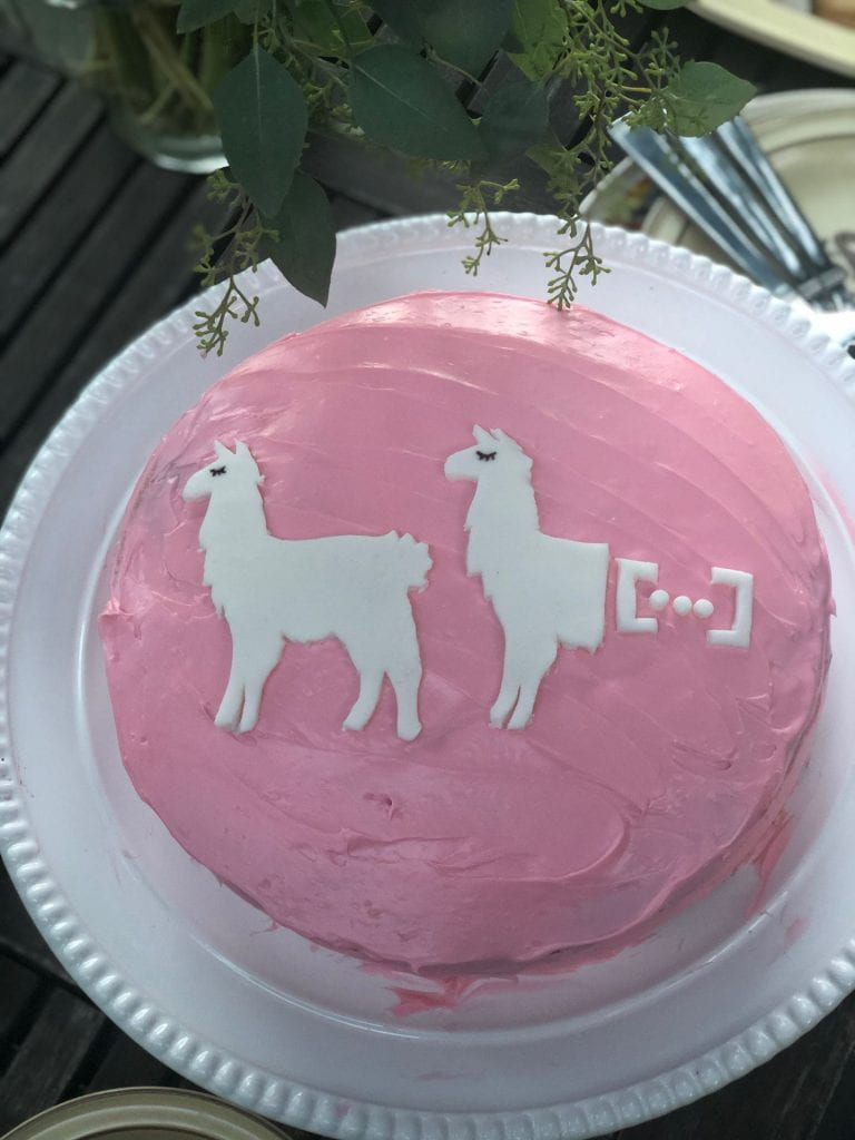 "A dissertation cake for Dr. Kroll, ""[untitled]"", prepared by Kelsey Kraus (PhD '18). White cake with fresh cherry filling and cream cheese frosting, with fondant llama antecedent & ellipsis site."