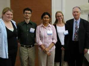 Photograph of four graduate students and Professor Emeritus, Edmund Burke III