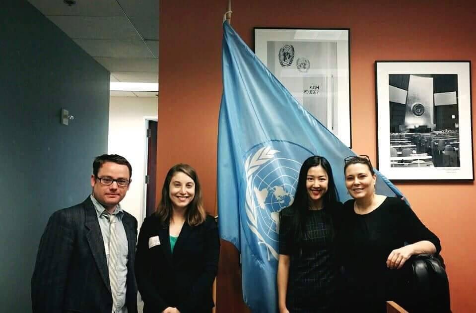 """Justin Chapman, Amanda Lester, Jung-hwa """"Judy"""" Kang, and Andi Gitow at the UN Information Center"""