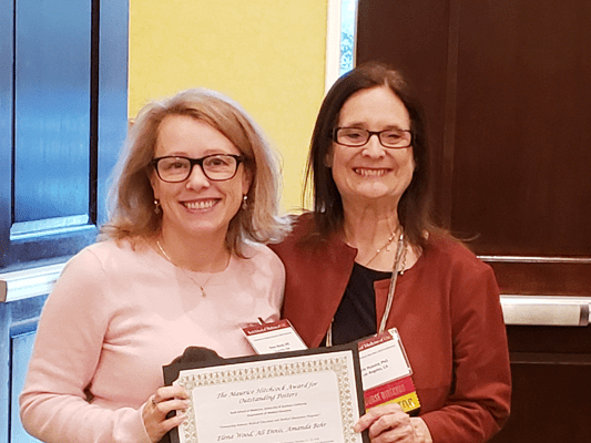 Dr. Elena Wood and Dr. Julie G. Nyquist