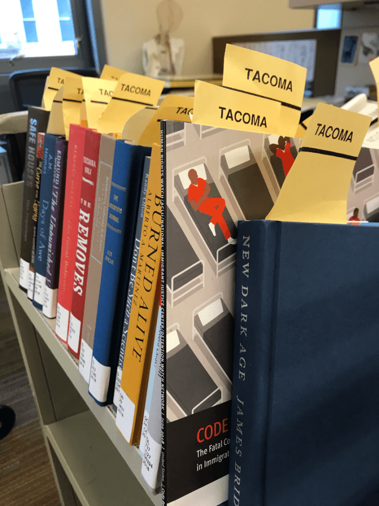 books on a cart ready for library processing