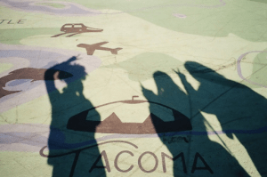 Urshula and friends taking pictures of their shadows on the Tacoma pier