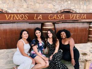 Adrianna posing with three friends at Vinos la Casa Vieja.