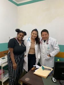 Adrianna and fellow UWT student Kirsten posing with a doctor in Bolivia at a local clinic