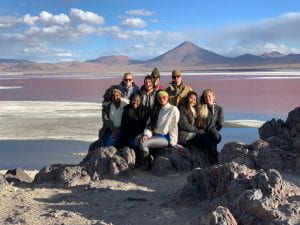 Adrianna posing with a group at the Salt flats