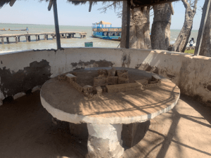 A replica model of how the Kunta Kenteh Island looked before erosion. You can see our boat in the background that soon got beached in that spot.