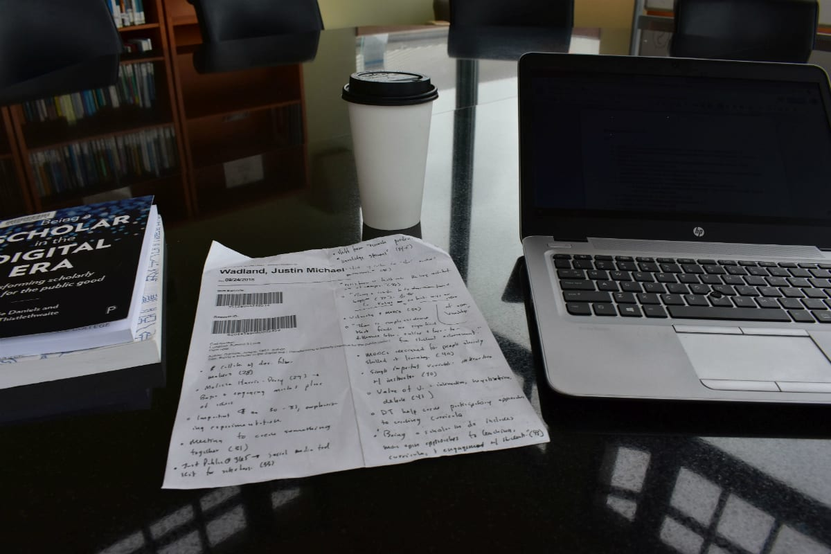 Photo showing book, notes, computer, and coffee cup on table. Taken just prior to meeting.