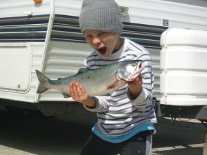 My brother Colton with a 2 lb salmon caught in the Puget Sound, 2007.