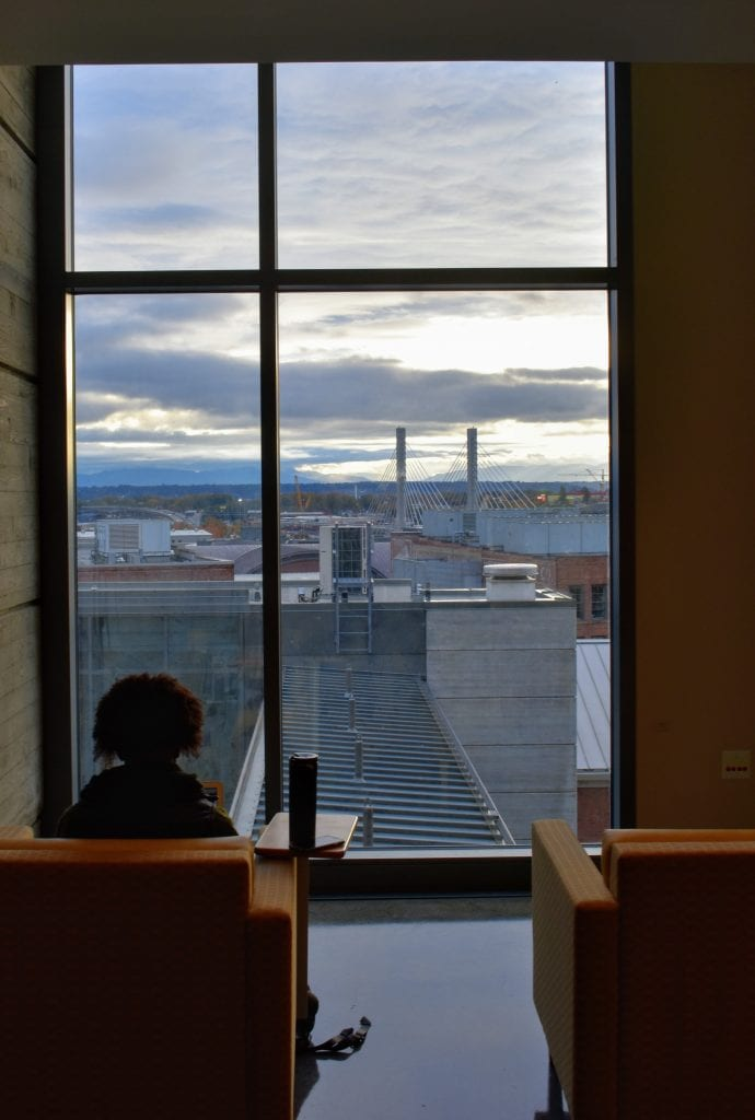 Student sitting in Tioga Library Building