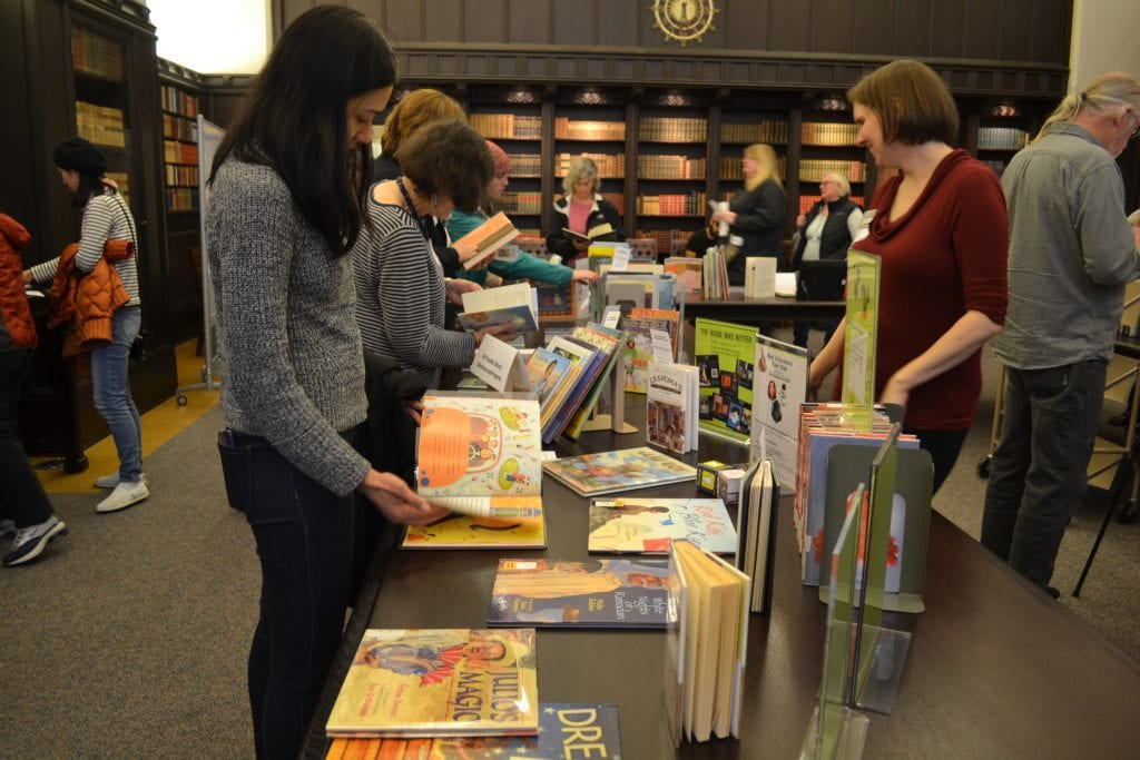 Visitors browse picture books at the children's literature open house