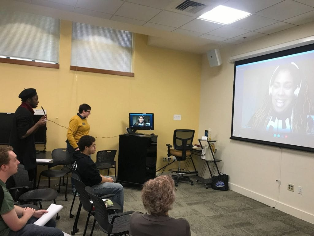 skype call on projected screen with an audience