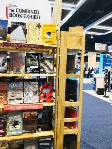 A bookshelf display of new academic titles
