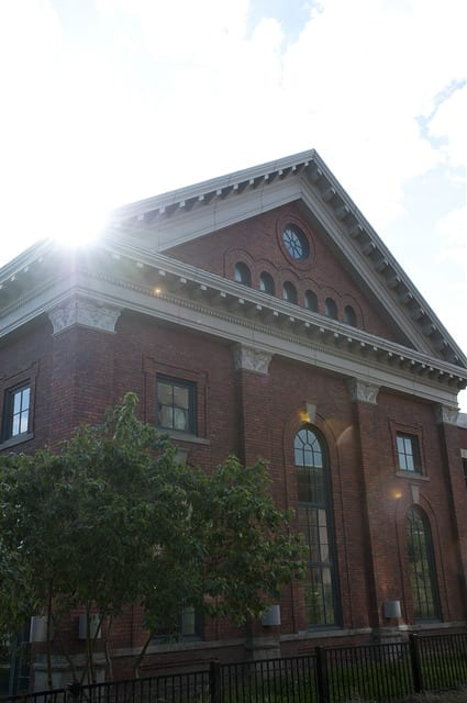 Image shows the Snoqualmie Building on the campus of UW Tacoma framed by sunlight.