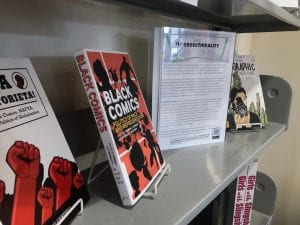 Photo of two books about graphic novels. One is entitled Black comics, and the other is about Mexican comics, though its title is not visible.