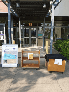 Entrance to Tioga Library Building with Curbside pickup signs