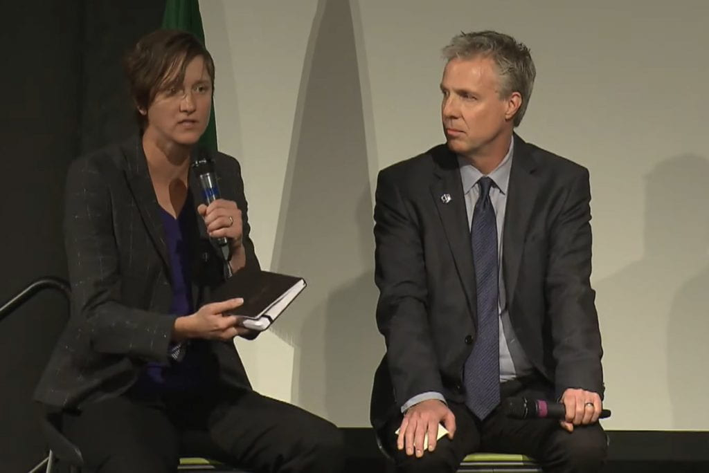 Image of Kate Starbird speaking while seated next to Chris Coward at the Center for an Informed Public launch event