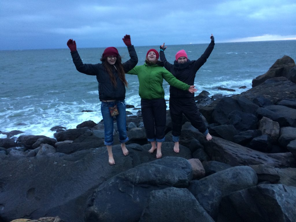 Angeline, Abby and Kaili enjoy the view at South Jetty after a long day of marine debris monitoring.