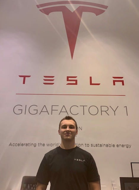 Jakub in front of Tesla sign