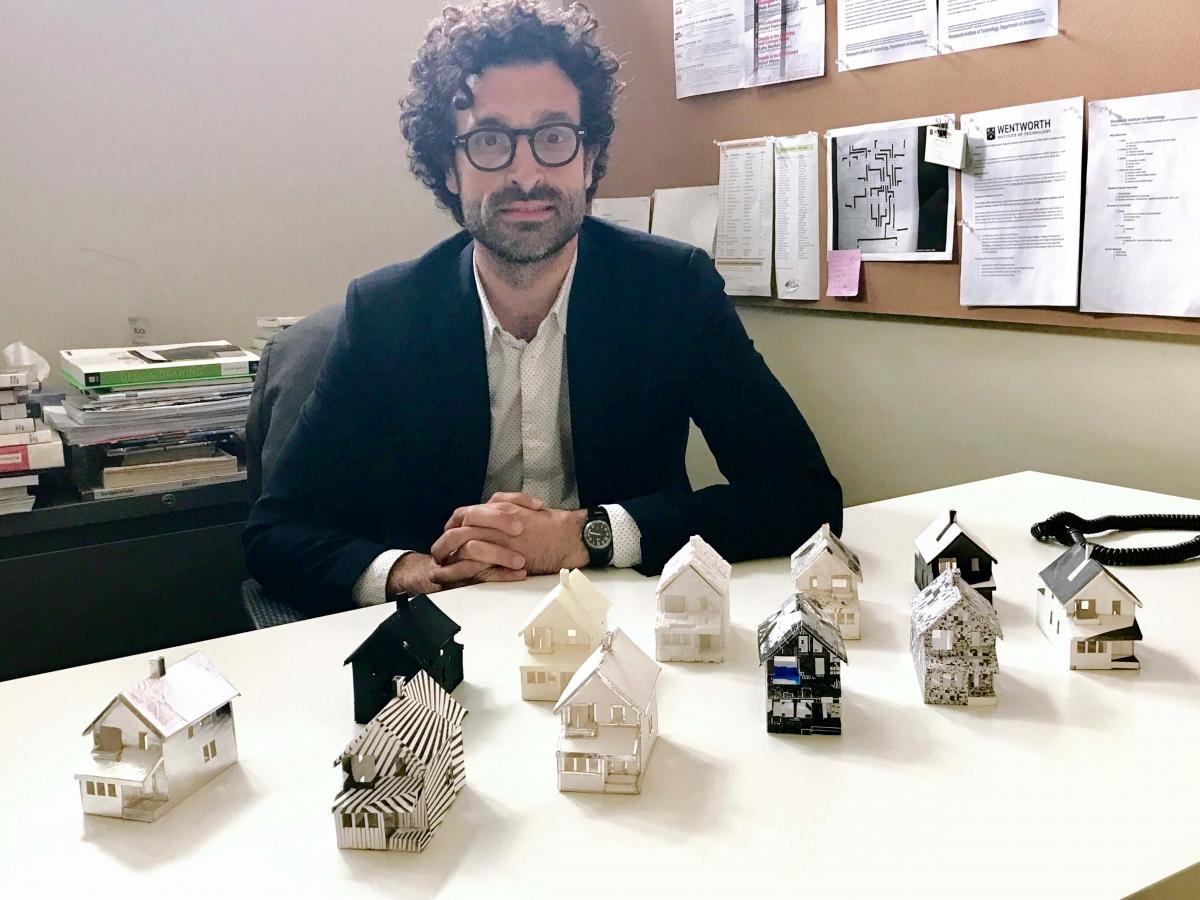Professor Antonio Furgiuele with some of his camouflaged model houses.