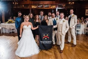 A wedding party holding the Wentworth banner