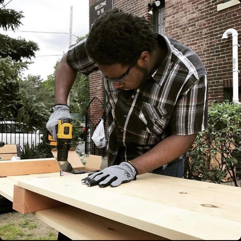 man using a power saw