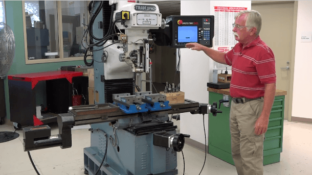 image of Professor Peter Rourke in front of the Vertical Milling Machine