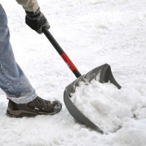Man shoveling snow after a heavy snowfall