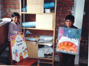 two children holding large Spanish books