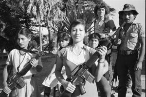 Two FMLN guerrillas holding automatic weapons