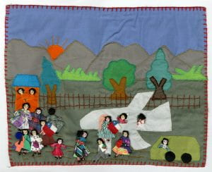 Detail from a patchwork quilt showing a sad airport scene as families and individuals were forced to flee Chile because of political persecution.