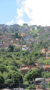 Photo of steep hillside with homes. Providing water to Caracas's hillside barrios such as Antímano is no easy feat.