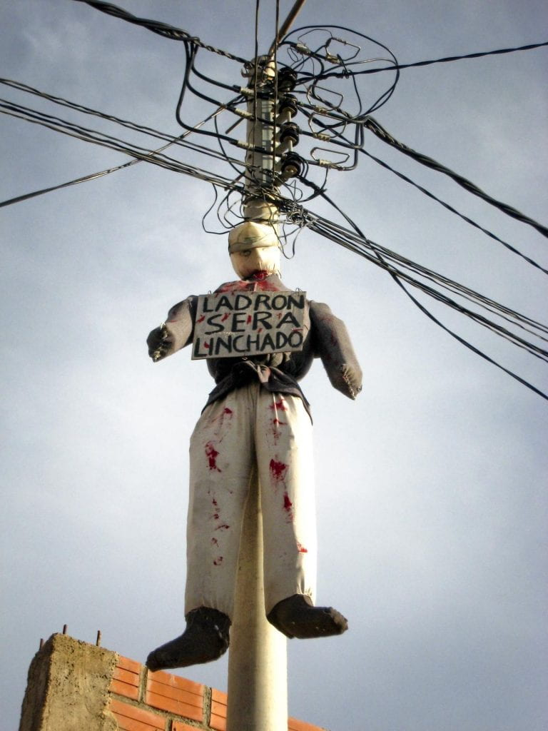 A lynched effigy with a warning sign that reads