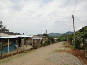 A street in Mocoa, Columbia, with homes to one side.
