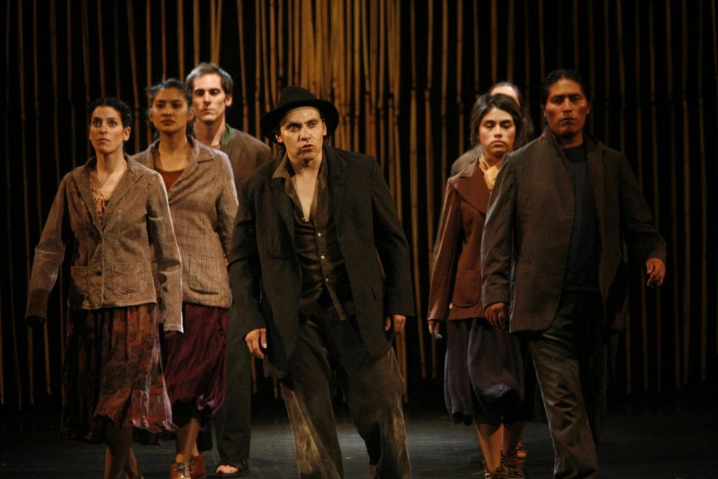 Seven actors and actresses perform on stage at La Odisea Teatro de los Andes during the he International Theater Festival.r