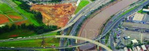 Photo of a river running between highways in São Paulo, Brazil.