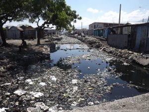 Photo of the polluted canal in Cité Féquiére, the poorest neighborhood within the Cité Soliel slum of Haiti.