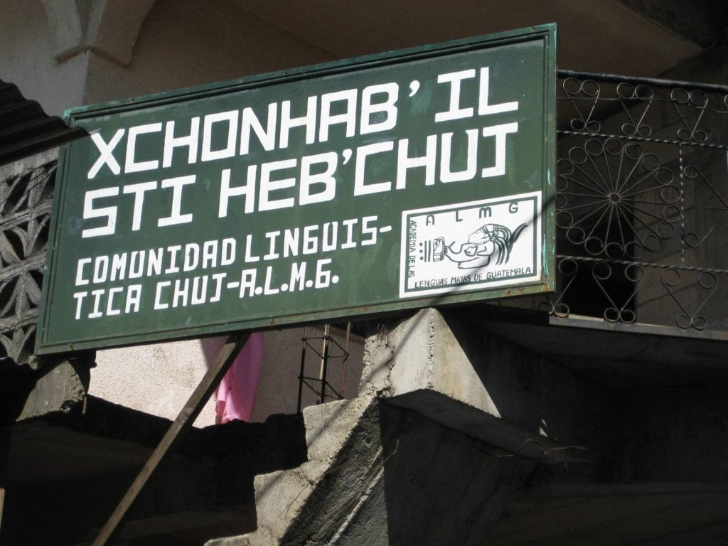 A bilingual sign on the Chuj-A.L.M.G. office