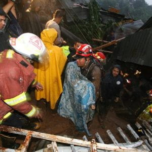 Photo of rescuers helping people after a storm.