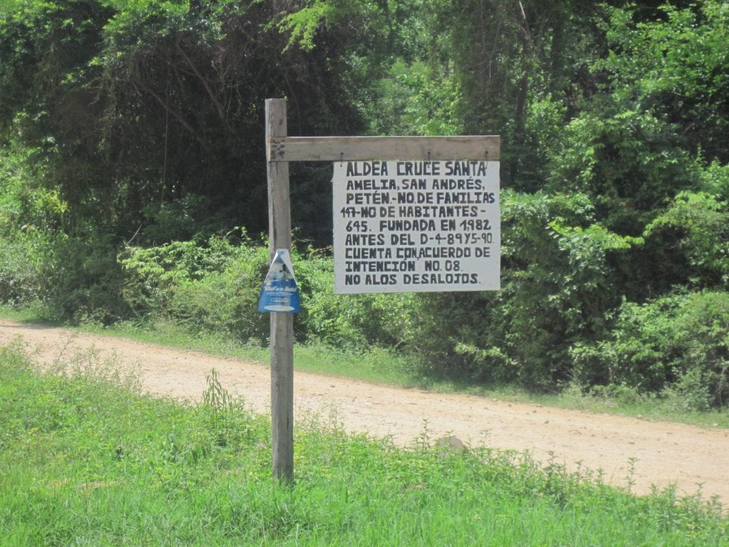 Photo of a road sign saying that the community was established before the area was named