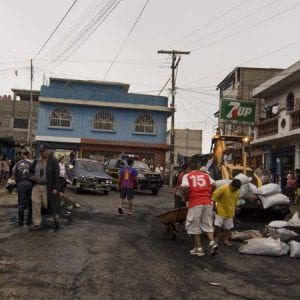 People in the street, cleaning up ash in Villa Nueva a town quite close to the volcano.