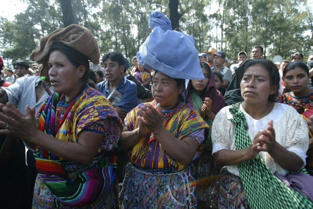 Indigenous women protesting in the streets.