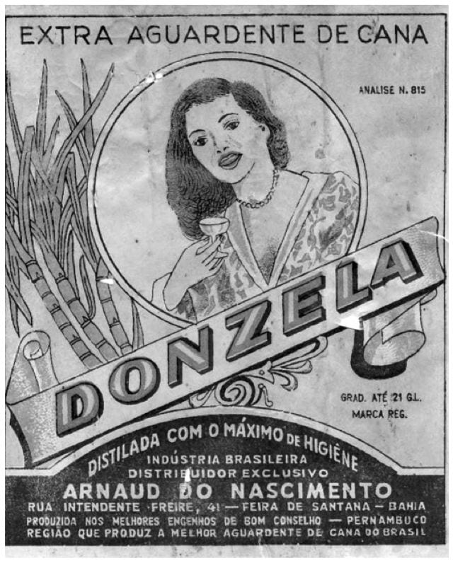 This label from a cachaça (firewater) bottle is a classic from Pernambuco. Image from James Ito-Adler's Cachaca Bottle Label-Collection. It features a woman with a small glass in her hand, and sugar canes to the side.