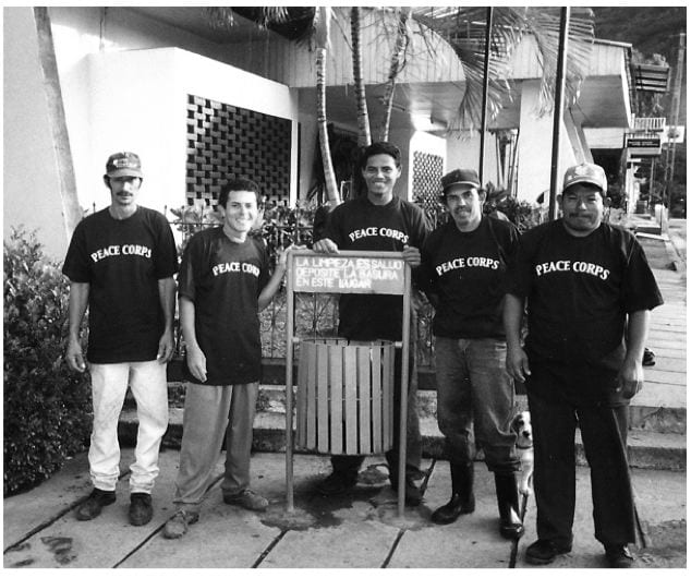 Five garbage men from la Trinidad wear Peace Corps T-shirts as thanks for their participation in a sanitation campaign.